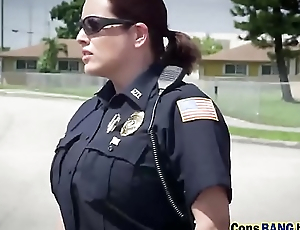 Busty policewomen breaching black stud outdoors